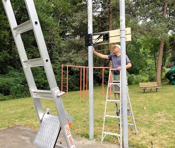 Tom Eshelman Installing new Basketball Goal